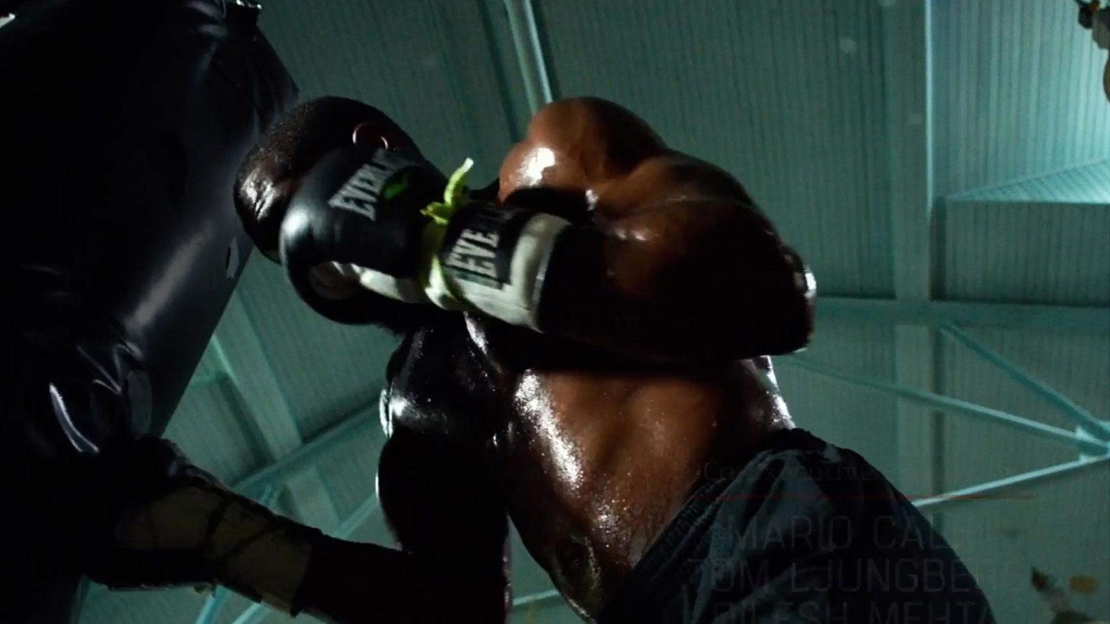 Background image of boxer punching a punching bag